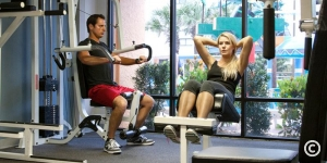Couple working out at The Caravelle Resort fitness center