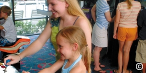 Mother and Daughter playing in the game room