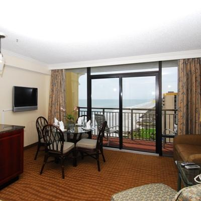 The Caravelle ocean view suite offers a bedroom with two double beds or one king bed and a living room with a double size wall bed. There is also a full kitchen and a flat screen tv in each room.