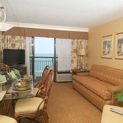The oceanfront suites at The Caravelle Resort offer a bedroom with two double beds or one king bed and a living room with a double size wall bed as well as a full kitchen and private balcony.
