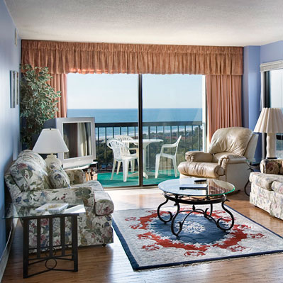The Sea Mark Tower 3 bedroom, 3 bathroom suites feature a living area with sofa sleeper.