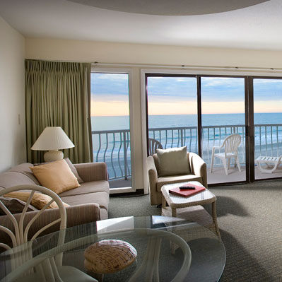 The St. Clement's oceanfront one bedroom suite features a living room with amazing ocean views.
