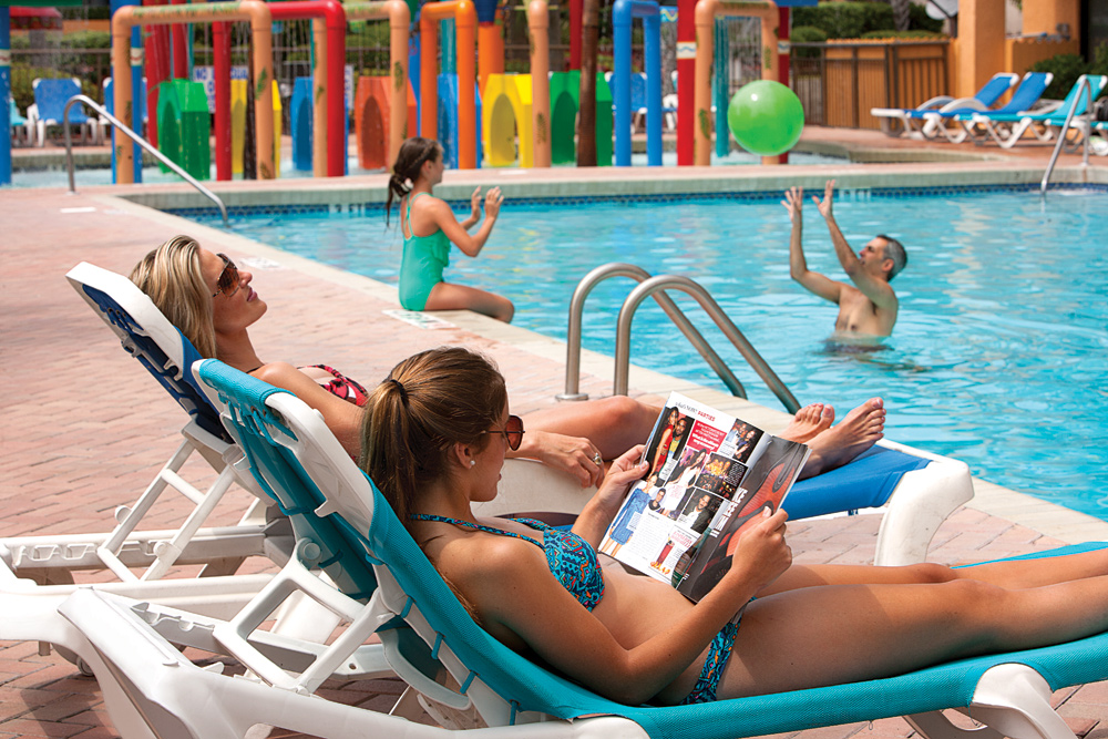 Family by the pool at Caravelle Resort