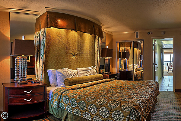 The Caravelle Resort Oceanfront Executive King Suite features a king bed, living room with wall bed and a full kitchen.